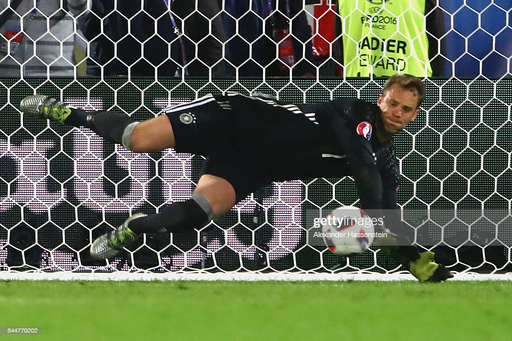 Manuel Neuer of Germany makes a safe during the penalty shootout of the UEFA EURO 2016 quarter final match between Germany and Italy at Stade Matmut Atlantique on July 2, 2016 in Bordeaux, France.