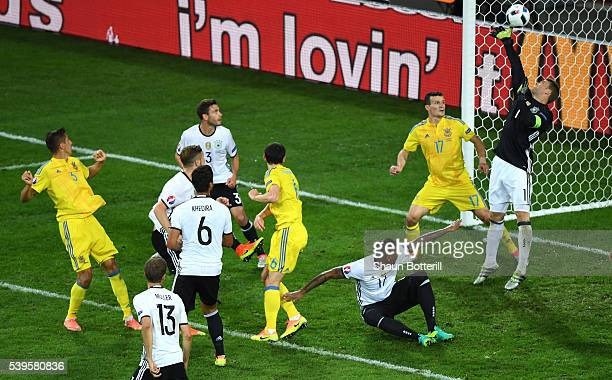 Manuel Neuer of Germany makes a save during the UEFA EURO 2016 Group C match between Germany and Ukraine at Stade PierreMauroy on June 12 2016 in...