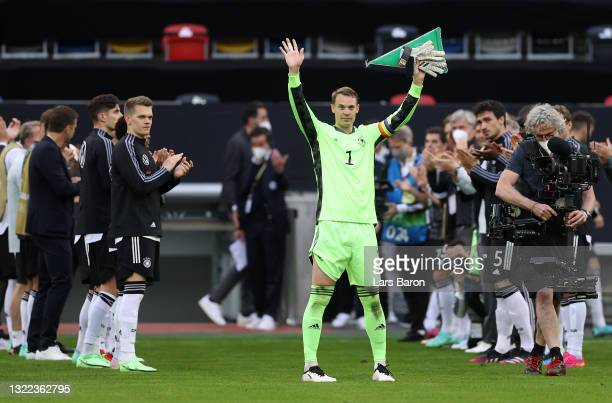 Manuel Neuer of Germany makes their way through a Guard of Honour as they prepare to play their 100th international match during the international...
