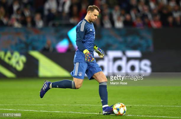 Manuel Neuer of Germany passes the ball during the International Friendly match between Germany and Serbia at Volkswagen Arena on March 20, 2019 in...