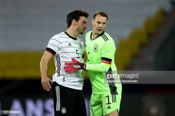 Manuel Neuer of Germany reacts with his team mate Mats Hummels during the international friendly match between Germany and Denmark at Tivoli Stadion...