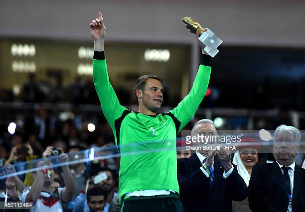 Manuel Neuer of Germany receives the Golden Glove trophy during the award ceremony after the 2014 FIFA World Cup Brazil Final match between Germany...