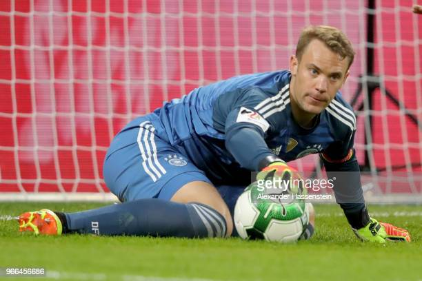 Manuel Neuer of Germany safes the ball during the International Friendly match between Austria and Germany at Woerthersee Stadion on June 2 2018 in...