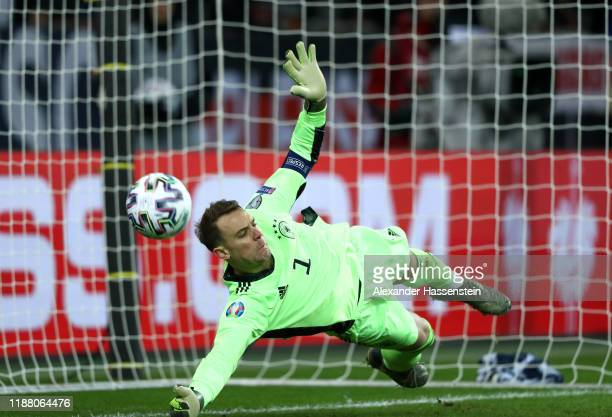 Manuel Neuer of Germany saves a penalty shot by Igor Stasevich of Belarus during the UEFA Euro 2020 Group C Qualifier match between Germany and...