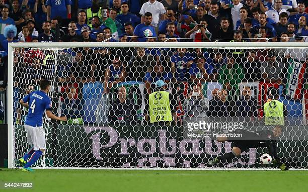 Manuel Neuer of Germany saves the penalty by Matteo Darmian of Italy at the penalty shootout during the UEFA EURO 2016 quarter final match between...
