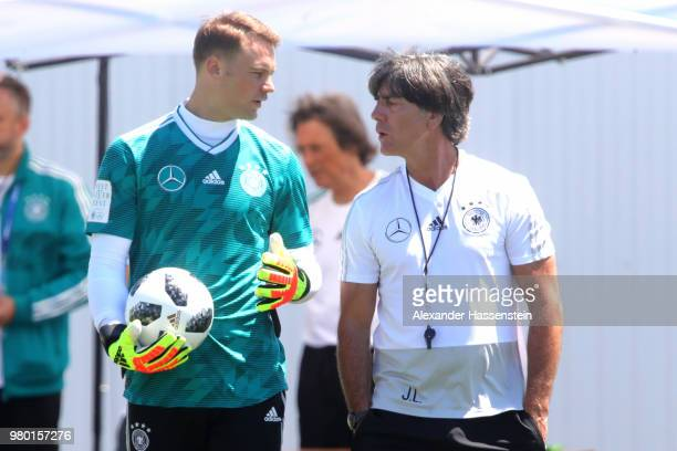 Manuel Neuer of Germany speaks with head coach Joachim Loew during the Germany Training Press Conference at Park Arena training ground on June 21...