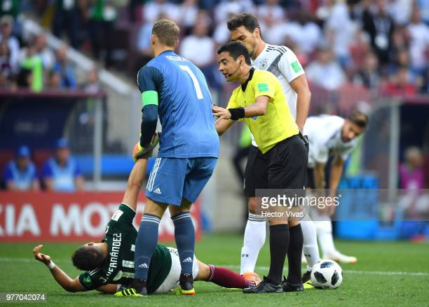 Manuel Neuer of Germany tryes to urge Javier Hernandez of Mexico to get up during the 2018 FIFA World Cup Russia group F match between Germany and...