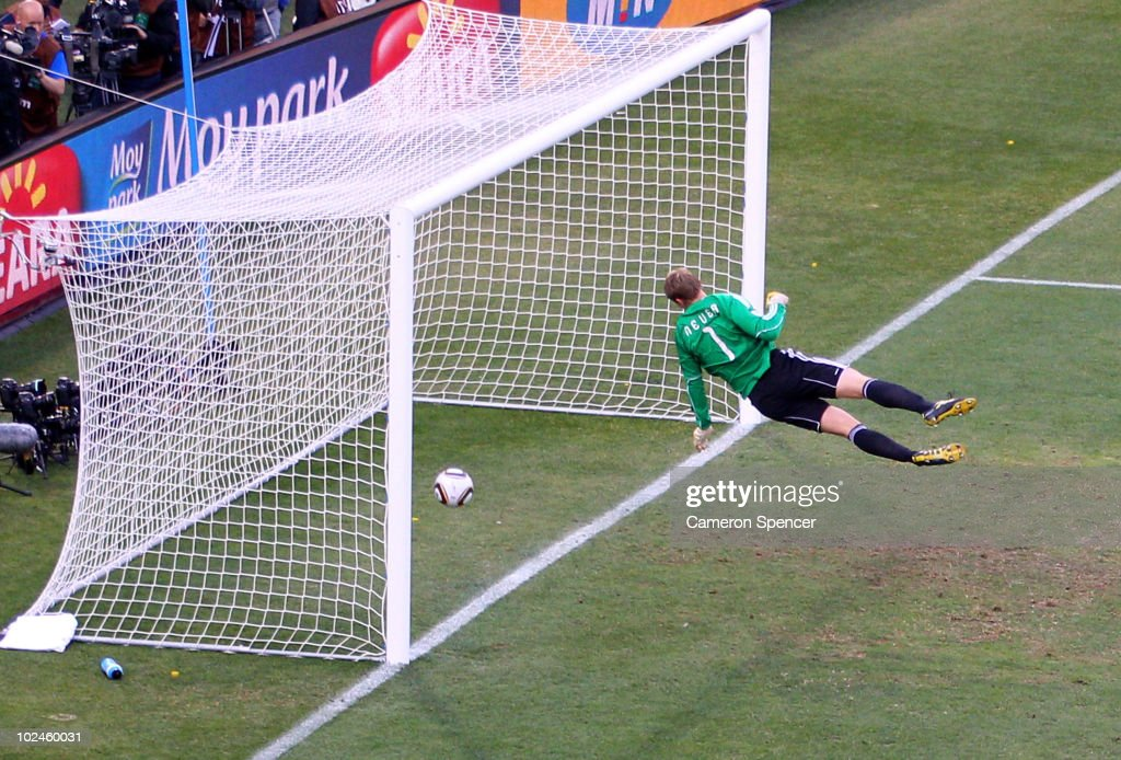 Manuel Neuer of Germany watches the ball bounce over the line from a shot that hit the crossbar from Frank Lampard of England, but referee Jorge Larrionda judges the ball did not cross the line during the 2010 FIFA World Cup South Africa Round of Sixteen match between Germany and England at Free State Stadium on June 27, 2010 in Bloemfontein, South Africa.