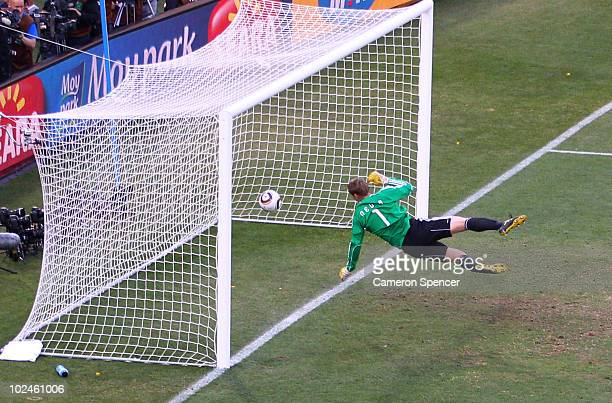 Manuel Neuer of Germany watches the ball bounce over the line from a shot that hit the crossbar from Frank Lampard of England, but referee Jorge...