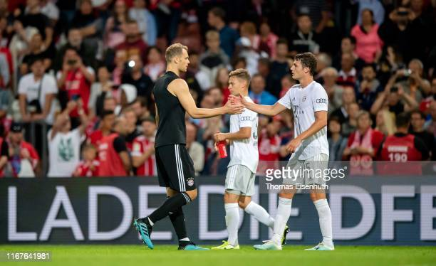 Manuel Neuer of Muenchen celebrates with Benjamin Pavard after the DFB Cup first round match between Energie Cottbus and FC Bayern Muenchen at...