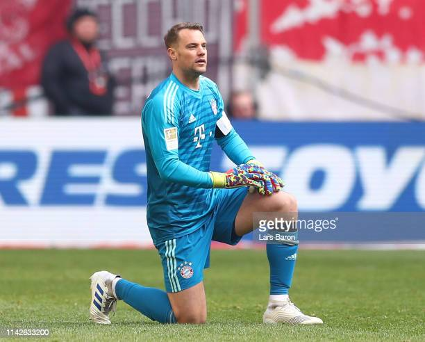 Manuel Neuer of Muenchen kneels down injured during the Bundesliga match between Fortuna Duesseldorf and FC Bayern Muenchen at EspritArena on April...