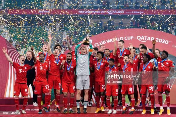 Manuel Neuer of Muenchen lifts the FIFA Club World Cup Qatar 2020 trophy after winning the FIFA Club World Cup Qatar 2020 final between Bayern...