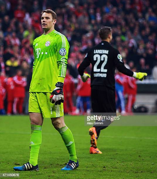 Manuel Neuer of Muenchen looks dejected as Mitchell Langerak of Dortmund celebrates during the penalty shoot out during the DFB Cup semi final match...