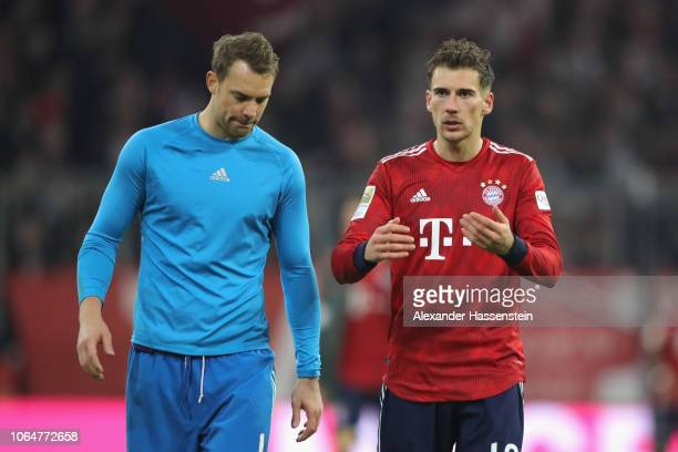 Manuel Neuer of Muenchen reacts with team mate Leon Goretzka after the Bundesliga match between FC Bayern Muenchen and Fortuna Duesseldorf at Allianz...