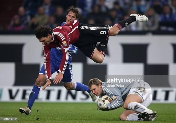 Manuel Neuer of Schalke and Angelos Charisteas of Nuernberg battle for the ball during the Bundesliga match between FC Schalke 04 and 1 FC Nuernberg...