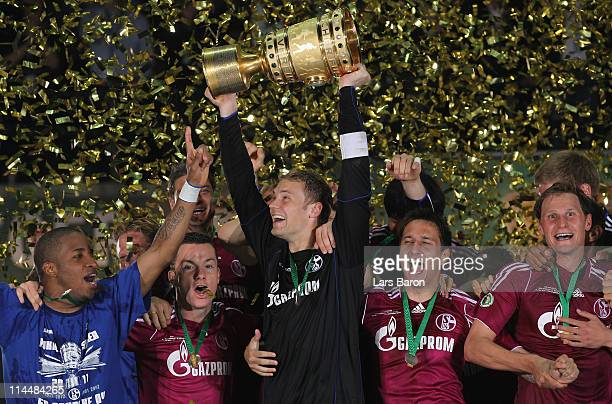 Manuel Neuer of Schalke lifts the trophy after winning the DFB Cup final match between MSV Duisburg and FC Schalke 04 at Olympic Stadium on May 21...