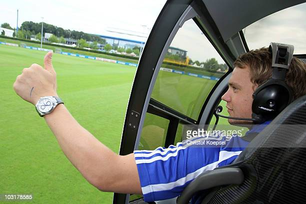 Manuel Neuer of Schalke sits in a helicopter during the FC Schalke 04 season opening around the Veltins Arena on July 31 2010 in Gelsenkirchen Germany