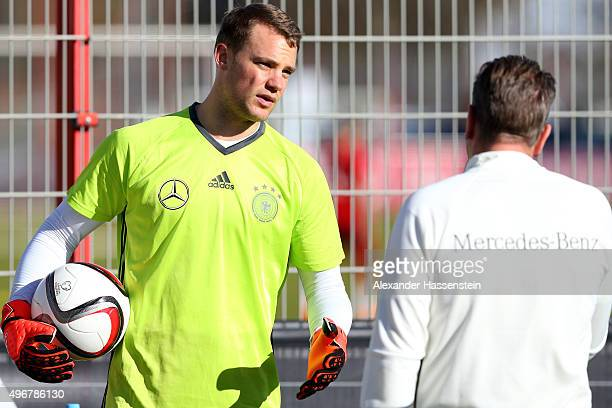Manuel Neuer of the German national team talks to assistent coach Andreas Koepcke during a training session at Bayern Muenchen's trainings ground...