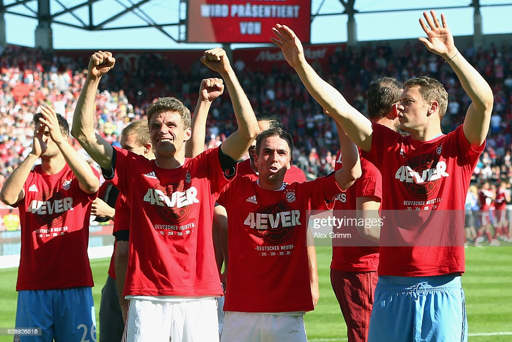 Manuel Neuer, Philipp Lahm, Thomas Mueller (R-L) of Muenchen celebrate being Bundesliga champions after beating Ingolstadt 2-1 in the Bundesliga match between FC Imgolstadt and FC Bayern Muenchen at Audi Sportpark on May 07, 2016 in Ingolstadt, Bavaria.