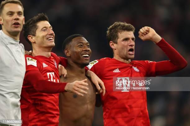 Manuel Neuer Robert Lewandowski David Alaba and Thomas Müller of FC Bayern Muenchen celebrate victory after winning the Bundesliga match between FC...