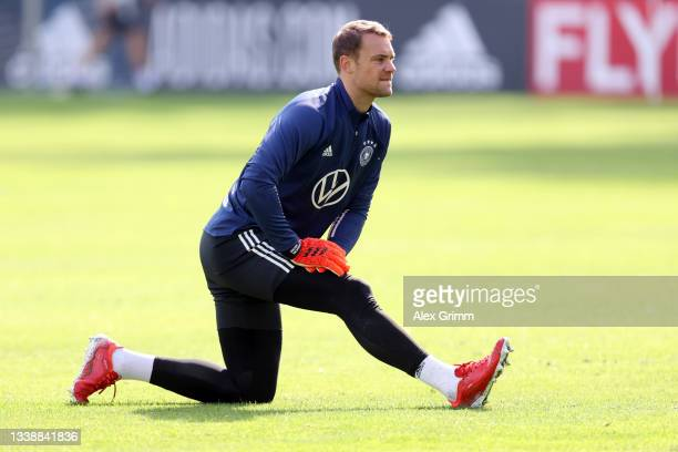 Manuel Neuer stretches during a Germany training session at ADM-Sportpark on September 07, 2021 in Stuttgart, Germany.