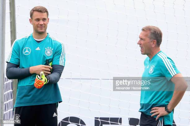 Manuel Neuer talks to his coache Andreas Koepcke during a training session of the German national team at Sportanlage Rungg on day seven of the...