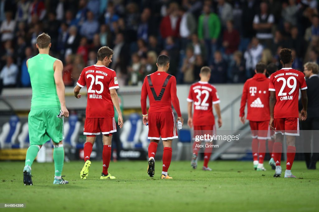 Manuel Neuer (l), Thomas Mueller of Bayern Muenchen (2nd left) and other player of Bayern leave the pitch dejected during the Bundesliga match between TSG 1899 Hoffenheim and FC Bayern Muenchen at Wirsol Rhein-Neckar-Arena on September 9, 2017 in Sinsheim, Germany.