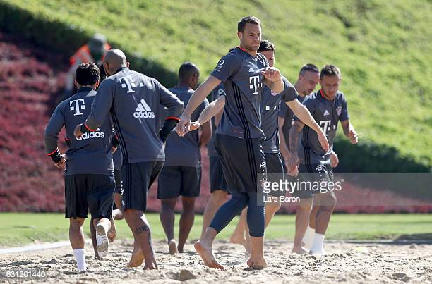 Manuel Neuer warms up in the sand during a training session at day 6 of the Bayern Muenchen training camp at Aspire Academy on January 8 2017 in Doha...