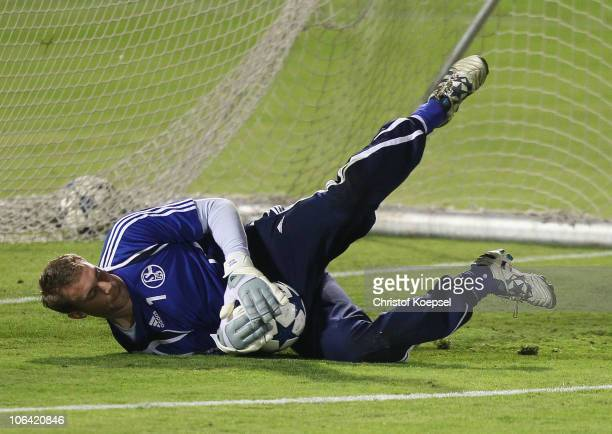 Manuel Neuerr saves a ball during a FC Schalke 04 training session ahead of the UEFA Champions League match against Hapoel Tel Aviv at Bloomfield...