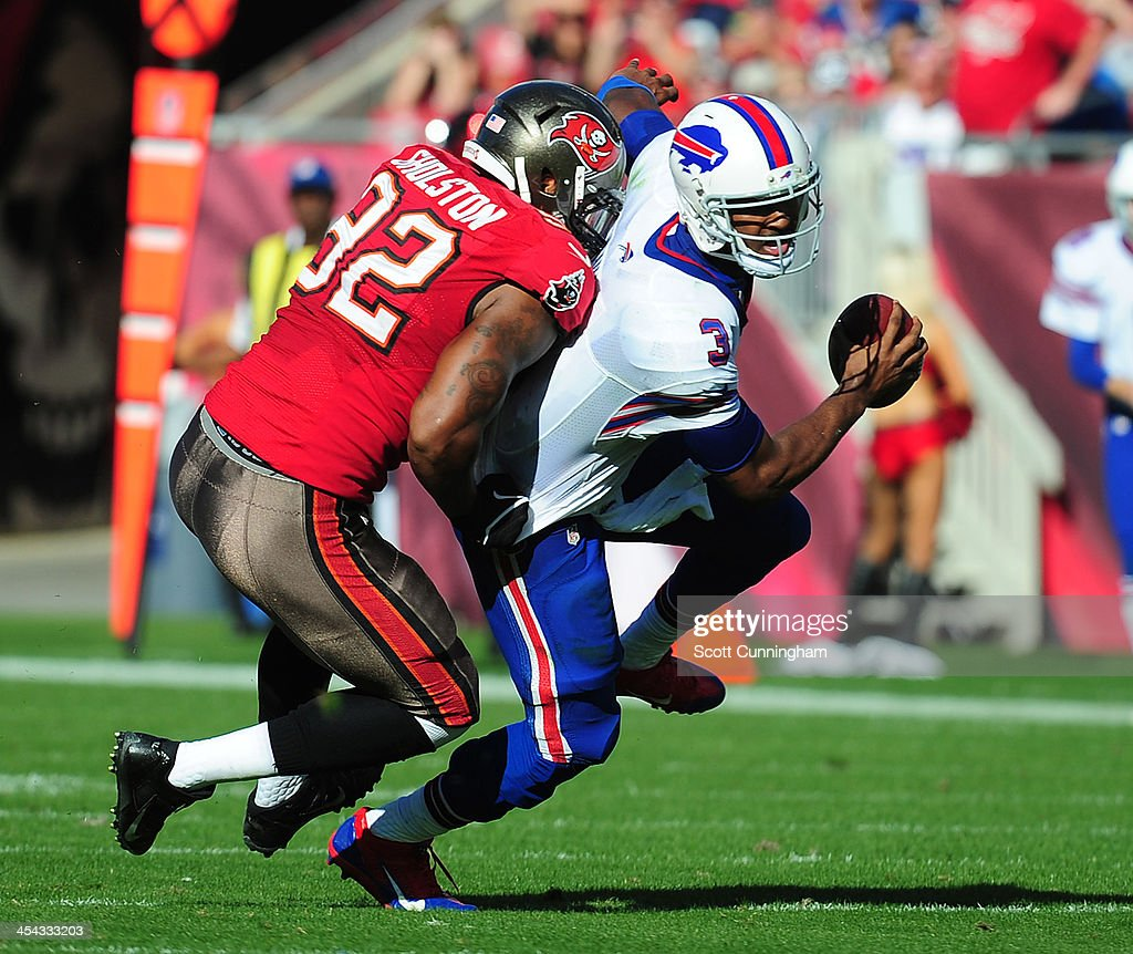 EJ Manuel #3 of the Buffalo Bills is sacked by William Gholston #92 of the Tampa Bay Buccaneers at Raymond James Stadium on December 8 2013 in Tampa, Florida.