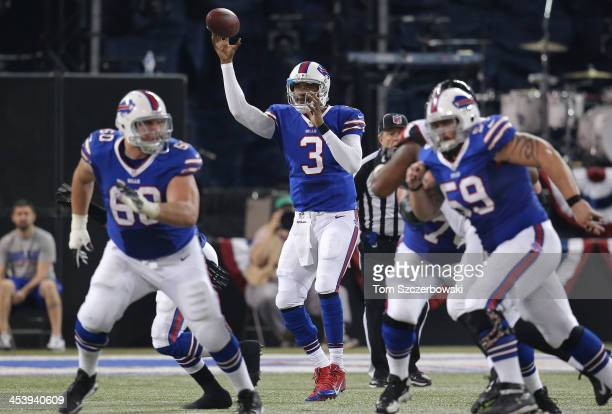 J Manuel of the Buffalo Bills throws a pass as he gets protection from Kraig Urbik and Doug Legursky during an NFL game against the Atlanta Falcons...
