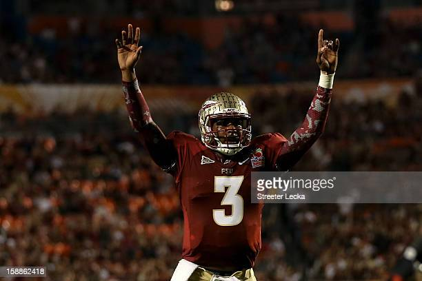 Manuel of the Florida State Seminoles celebrates after he threw a 6yard touchdown pass to Rashad Greene in the second quarter against the Northern...