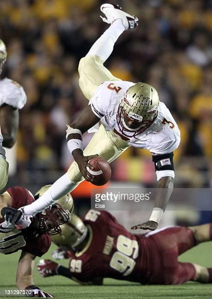 Manuel of the Florida State Seminoles is tackled by Luke Kuechly of the Boston College Eagles on November 3, 2011 at Alumni Stadium in Chestnut Hill,...