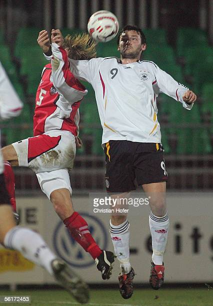 Manuel Ortlechner of Asutria goes up for a header against Benjamin Auer of Germany during the international friendly match between Germany Team 2006...