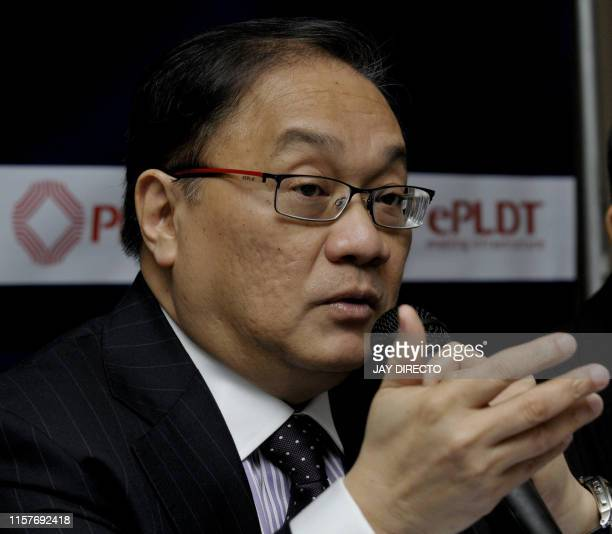 Manuel Pangilinan chairman of Philippine Long Distance Telephone Co addresses the company's annual stockholders' meeting in Manila's financial...
