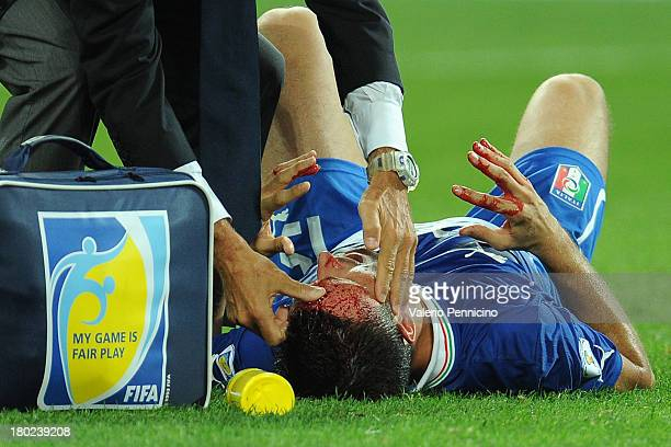 Manuel Pasqual of Italy receives treatment to a head injury during the FIFA 2014 World Cup Qualifier group B match between Italy and Czech Republic...