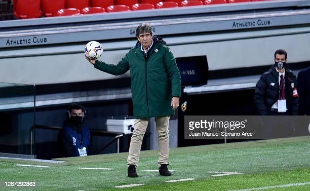 Manuel Pellegrini, Head Coach of Real Betis catches the ball during the La Liga Santander match between Athletic Club and Real Betis at Estadio de...