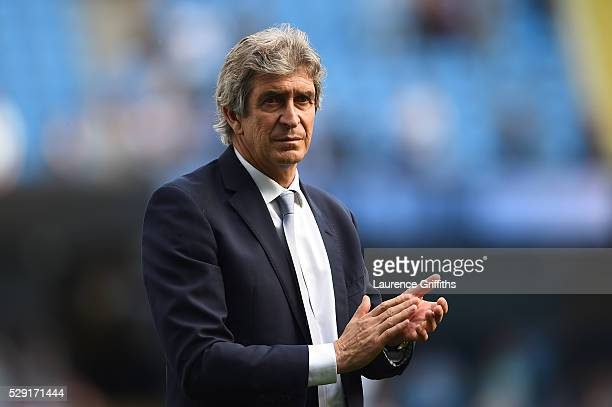 Manuel Pellegrini Manager of Manchester City acknowledges the fans followin the Barclays Premier League match between Manchester City and Arsenal at...