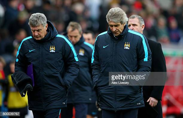 Manuel Pellegrini manager of Manchester City and caoch Brian Kidd leave the pitch at the half time during the Barclays Premier League match between...