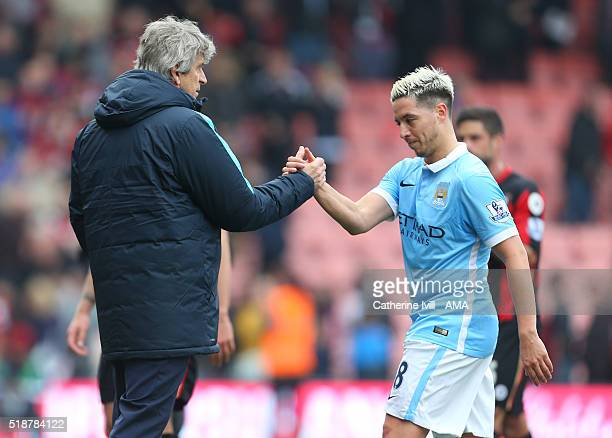 Manuel Pellegrini manager of Manchester City and Samir Nasri of Manchester City during the Barclays Premier League match between AFC Bournemouth and...