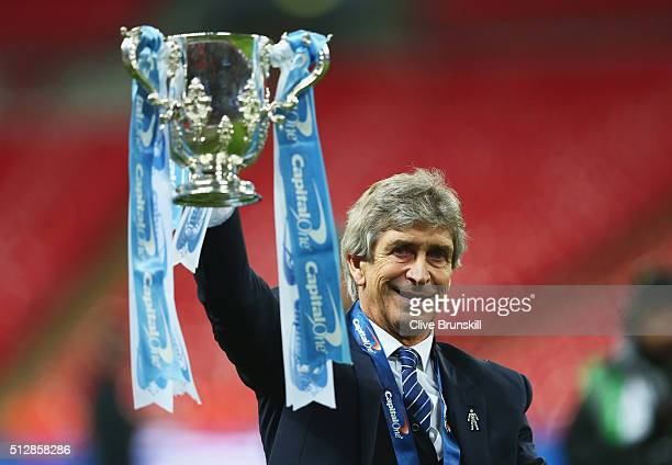 Manuel Pellegrini manager of Manchester City celebrates victory with the trophy after the Capital One Cup Final match between Liverpool and...