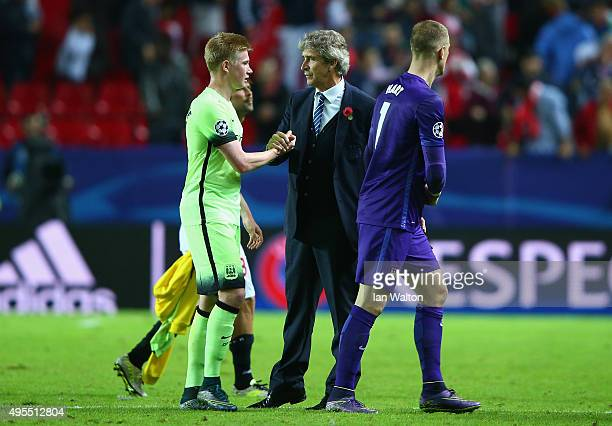 Manuel Pellegrini manager of Manchester City congratulates Joe Hart of Manchester City and Kevin de Bruyne of Manchester City following the UEFA...