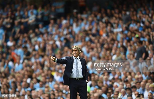 Manuel Pellegrini Manager of Manchester City gestures from the touchline during the Barclays Premier League match between Manchester City and Arsenal...