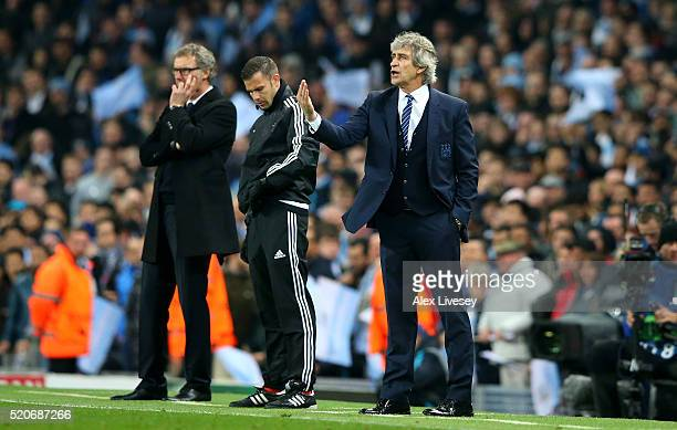 Manuel Pellegrini manager of Manchester City gives instructions as Laurent Blanc manager of Paris SaintGermain look on during the UEFA Champions...
