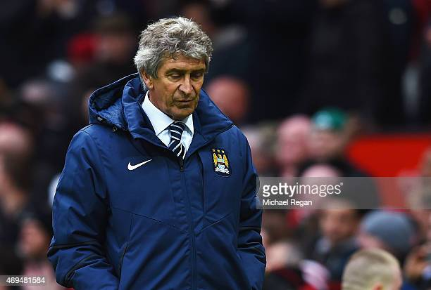 Manuel Pellegrini manager of Manchester City looks depsondetn in defeat after the Barclays Premier League match between Manchester United and...
