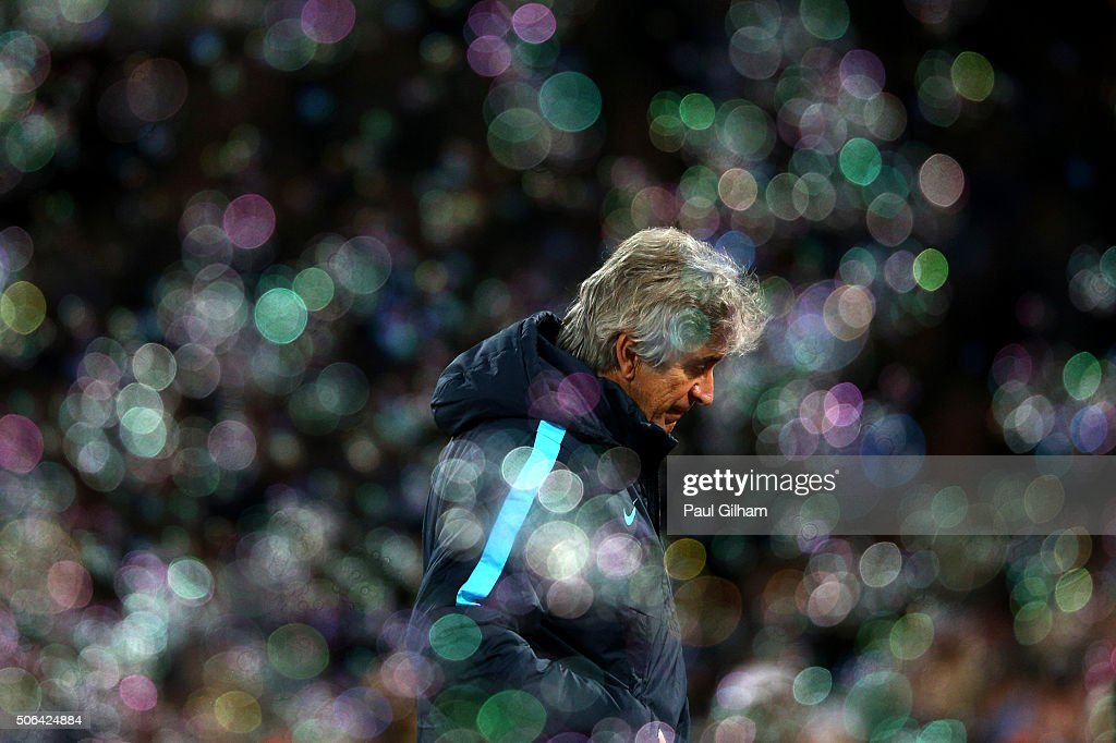 Manuel Pellegrini manager of Manchester City looks despondent as bubbles fill the air during the Barclays Premier League match between West Ham United and Manchester City at the Boleyn Ground on January 23, 2016 in London, England.