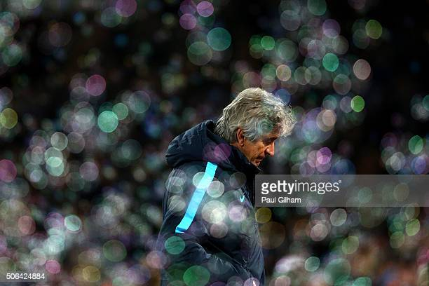 Manuel Pellegrini manager of Manchester City looks despondent as bubbles fill the air during the Barclays Premier League match between West Ham...