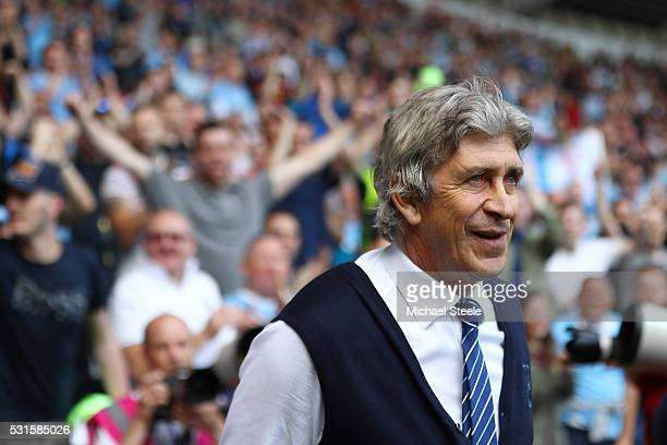 Manuel Pellegrini manager of Manchester City looks on after the Barclays Premier League match between Swansea City and Manchester City at the Liberty...