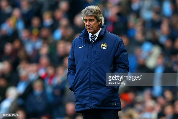 Manuel Pellegrini manager of Manchester City looks on during the FA Cup Fourth Round match between Manchester City and Middlesbrough at Etihad...