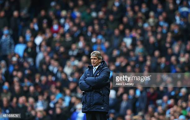 Manuel Pellegrini manager of Manchester City looks on during the Barclays Premier League match between Manchester City and Tottenham Hotspur at...